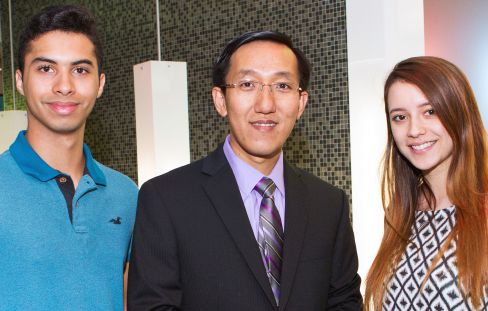 Dr. Hien Nguyen, center, uses DynaFlip to connect with students like Carlos Julio Castillejos and Carla Andreina Mariani.