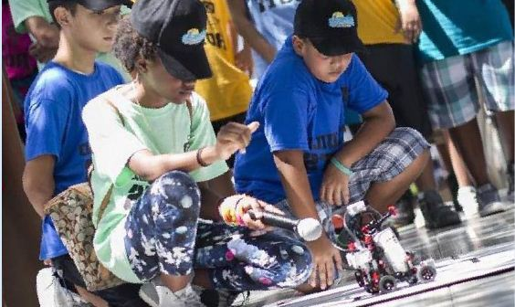 Students from MDC's summer Robotics Camps test their creation.
