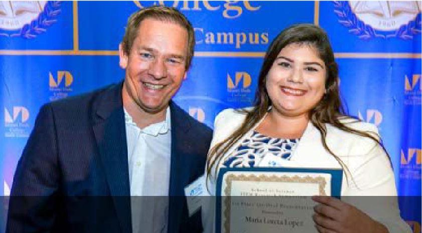 STEM Research Symposium winner Maria Loreta Lopez (right) with her mentor, MDC professor Dr. James Ley