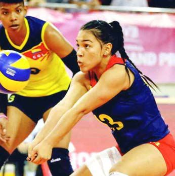 Camila Hernandez digs a hard-hit spike while representing Colombia.