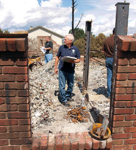 FEMA and the Preliminary Damage Assessment team evaluate damage to a home after the Waldo Canyon Fire in Colorado, 2012.