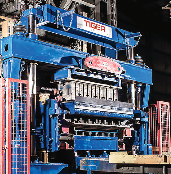 Figure 7B. Panel actuated and hydraulically operated S Series is equipped with quick mold change system which releases mold compression head directly from control panel