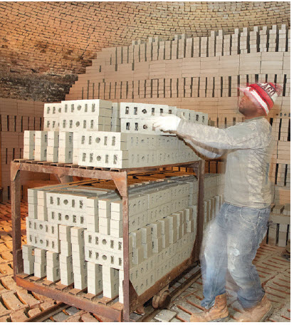 Unfired brick are loaded in beehive kiln where they are heated and allowed to completely cool.