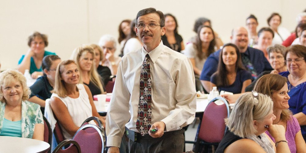 Speaker Mike Patin encourages the diocese's nearly 250 Catholic school teachers and principals to reconnect with their commitment to Catholic education.