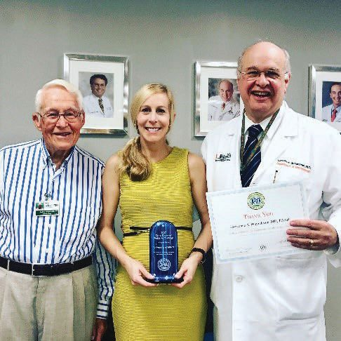 Representing the University of Miami, from left to right, are Andrew Margileth, MD, Kate Oberlin, MD, and Lawrence Schachner, MD.
