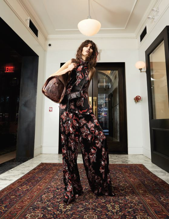 Victoria Hayes top and pants Jennifer Fisher earrings Coach bag