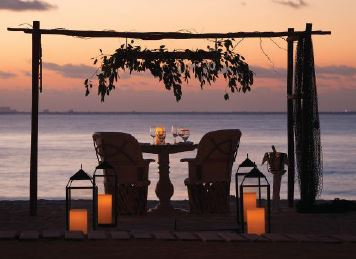 Quiet beach dinners for two spell romance.
