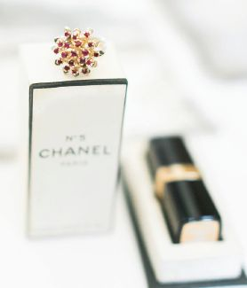Heirlooms make the day more personal: The vintage cocktail ring and Chanel box were lent by family members.