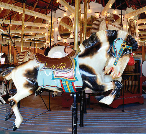 Two vintage carousels at the museum are ready to ride: the 1916 Special #1 (above) and the c. 1940s Kiddie Carousel. Photo credit: Herschell Carrousel Museum.