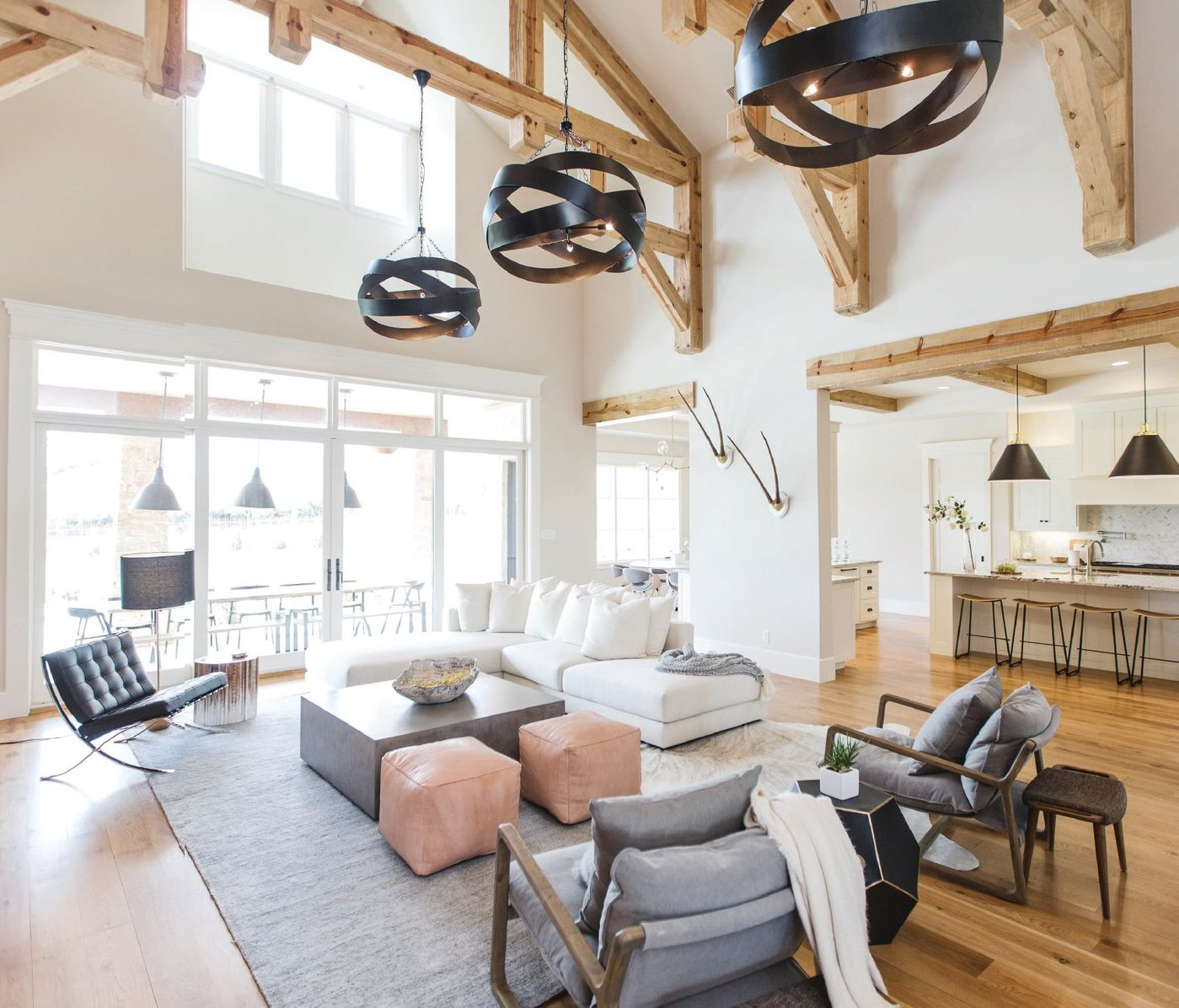 For designer Ginger Curtis, the great room posed one of the biggest (literally) challenges. A trio of sculptural metal pendants solved the lighting situation. Custom furniture, including a sectional, anchors the room's center without blocking views of the patio and kitchen