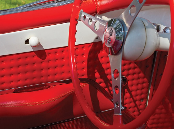 The original upholstery matches the red of the steering wheel.