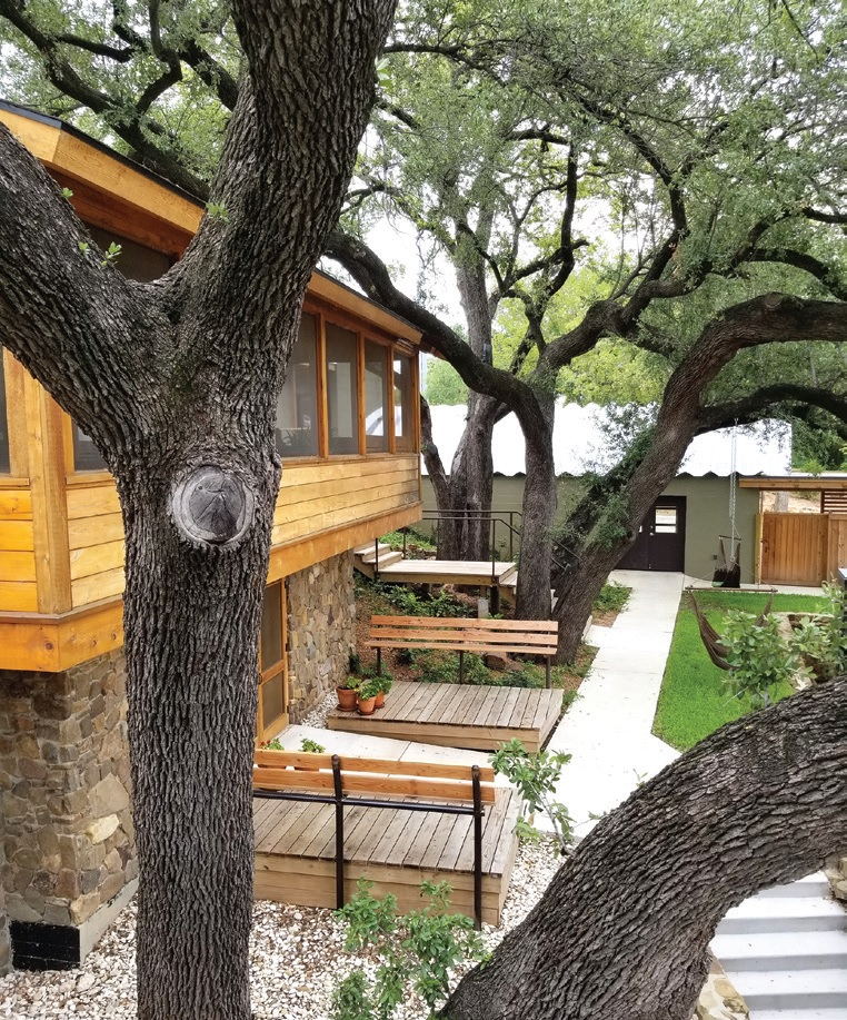 Trees frame the guest quarters and the gym.