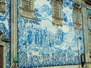The glazed tile known as azulejos date to the 13th century, when the Moors invaded Portugal. The word means polished stone.