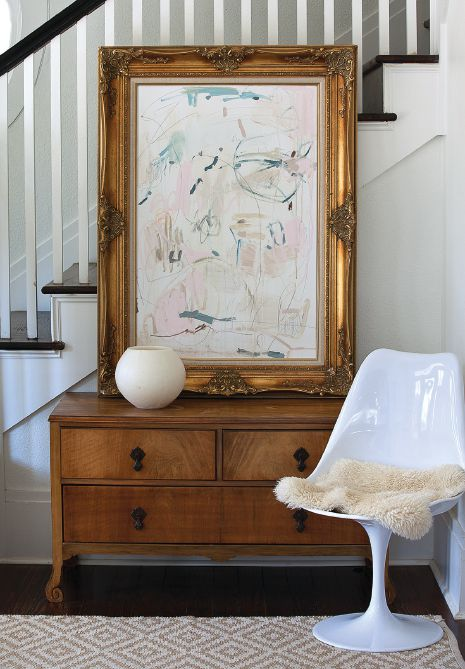 The home serves as an informal gallery for Heather Essian's artwork. The painting in a formal frame is propped atop a family heirloom chest, a juxtaposition that speaks to her love of surprising contrasts.