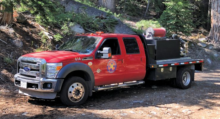 Rapid Response Force's National Wildfire Coordinating Group Type-6 fire engine standing by on the site. The U.S. Forestry Service can require companies to have a water tank on scene. Many federal contracts require tanks and hoses during fire season when doing this kind of work. Photo courtesy of Rapid Response Force.