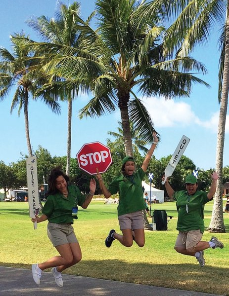 Sacred Hearts Academy Leos (from left) Kennedy Cambra-Cho and Ally Montiel and Kamehameha Lion Whitney Miyahira jump into volunteering as PGA marshals for the Sony Open, an annual project of the Lions and Leos.