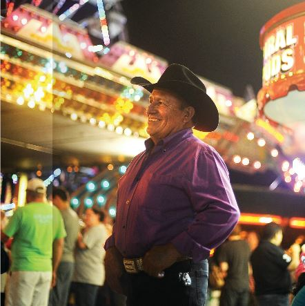 Region Cervantes stands among the carnival lights at the Cullman County Fair.