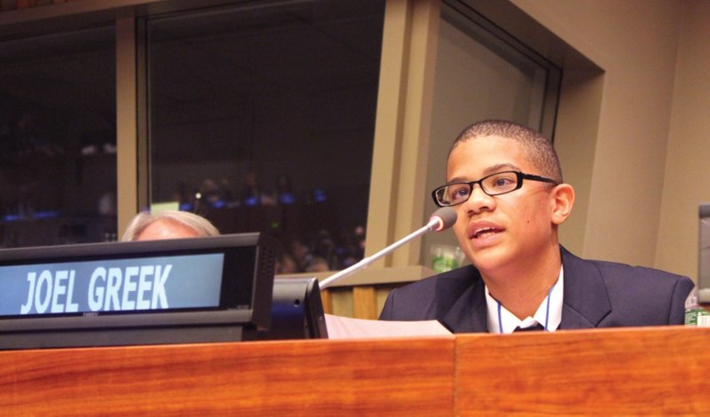 Joel Greek reads his essay at Lions Day with the United Nations in March.