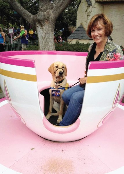 Disneyland is the happiest place on earth for puppies, too, as Fiji takes a ride on the teacups with Murrieta Lion Judy Buehler.