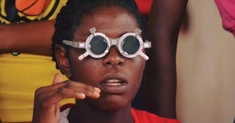 A young woman receives an eye screening at an Access to Success health clinic in Nigeria.