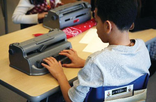 A student competes in the NYC Braille competition sponsored by Lions.