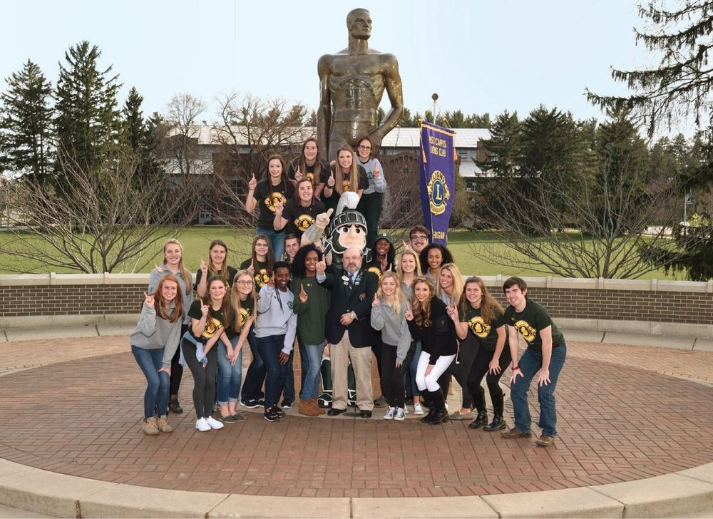 The Michigan State University Lions Club gathers at the iconic Spartan Statue on campus.  Joining members are 2015-16 District 11 C2 Governor Russ Amidon (see if you can guess which one he is), and Sparty, the university's muscular mascot.