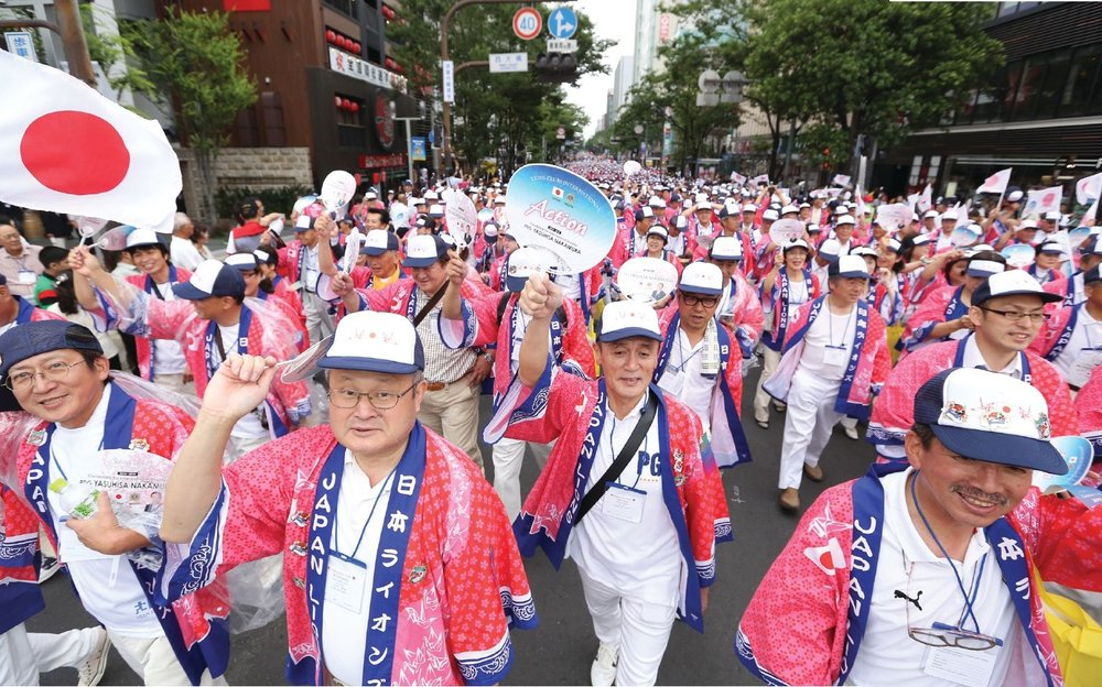 Thousands of Japanese Lions march in Fukuoka during the grand Parade of Nations.