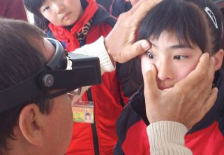 Thanks to Lions, a child in China is checked for trachoma.