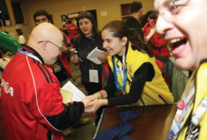 A Special Olympics athlete enjoys his new eyeglasses after a vision exam.