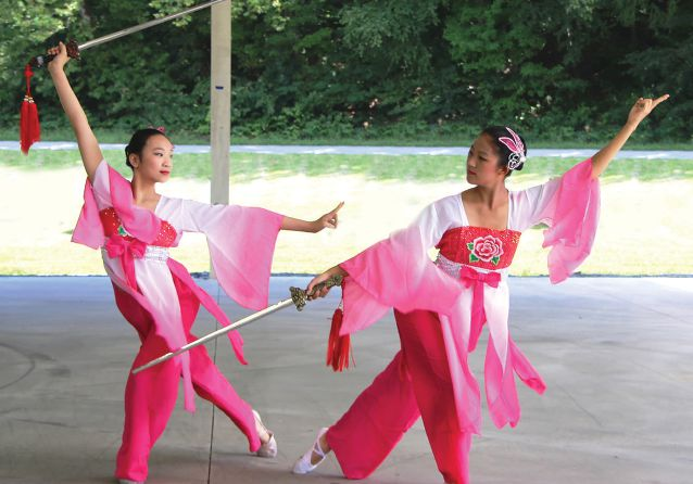 Edison Metro Leos Lucy Gao (left) and Melanie Zhang perform the sword dance for an audience in New Jersey.