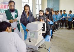 The Lahore Green View Lions Club in Pakistan holds a vision screening for schoolchildren.