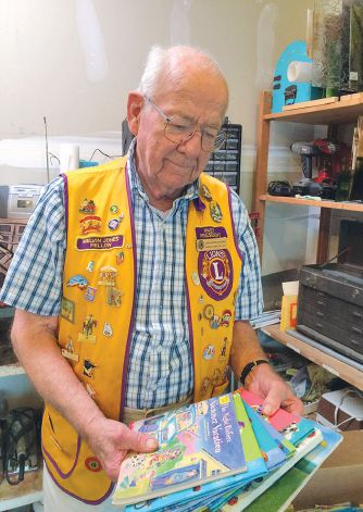 From his garage, Lion Gordon Simonson of Minnesota leads his club in collecting and shipping gently-used children's books to Africa to help create libraries and a new generation of readers.