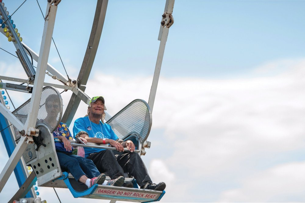 Bob Karsc enjoys the view on the Ferris wheel ride during the Special Needs Day.