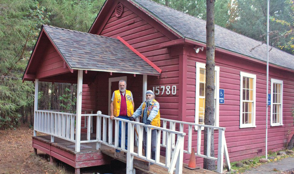 John Cappa (right), president of the Cobb Mountain Lions Club, and Vice President Mike Dunlap stand in front of their clubhouse, used as a recovery center after the fire.