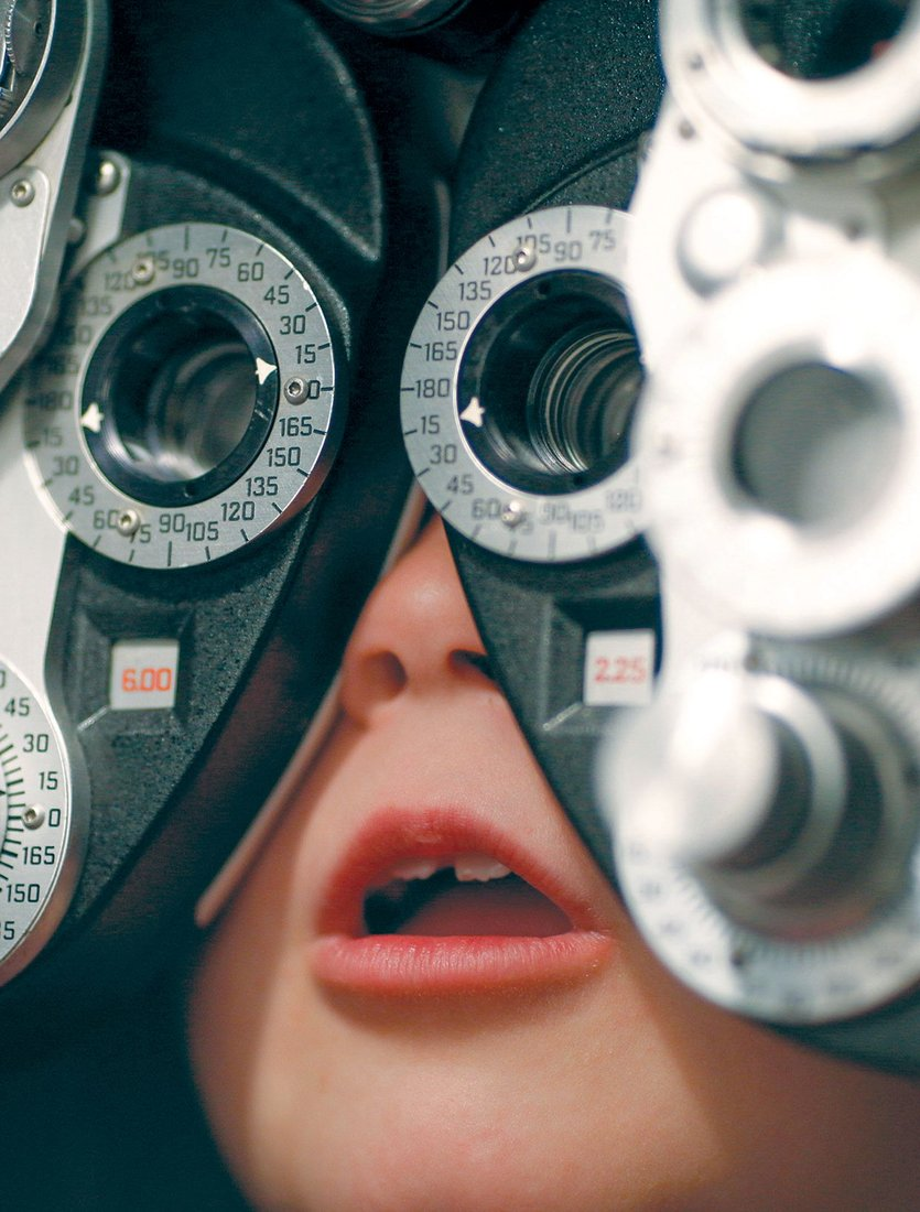 A child's eyes are checked at the Slater-Marietta Lions Club in South Carolina. Photos by Jason E. Miczek/AP Images