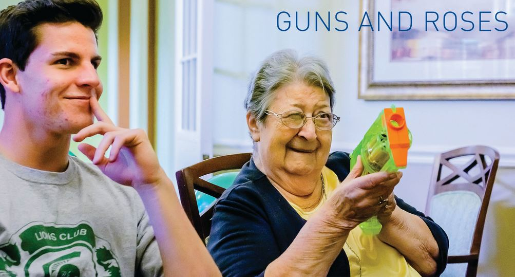 Connor Tinsley of the MSU Campus Lions Club in Michigan admires the shooting prowess of a resident at a senior home. The Lions bring flowers and games on their regular visits to the home (story on page 30). // PHOTO BY KEVIN FOWLER