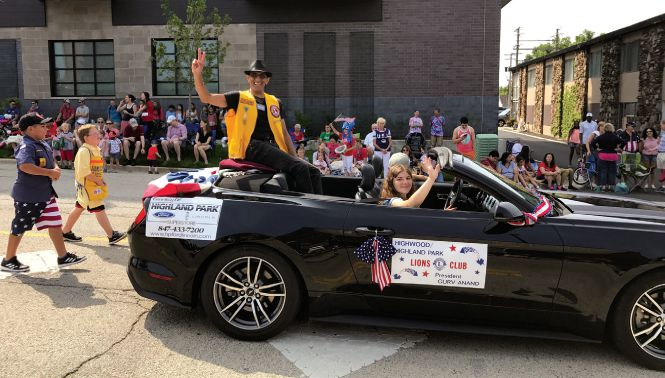 President Guv Anand of the Highland Park/Highwood Lions Clubin Illinois was chosen as grand marshal for the town's Fourth of July parade. The parade theme was community service.
