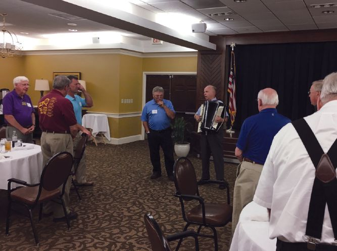 The Shawnee Lions in Virginia, led by professional accordion player and Lion Edward Touchstone, enjoy a wide repertoire when it comes to starting the meeting with a song. Photo by Lion Byron Clemsen