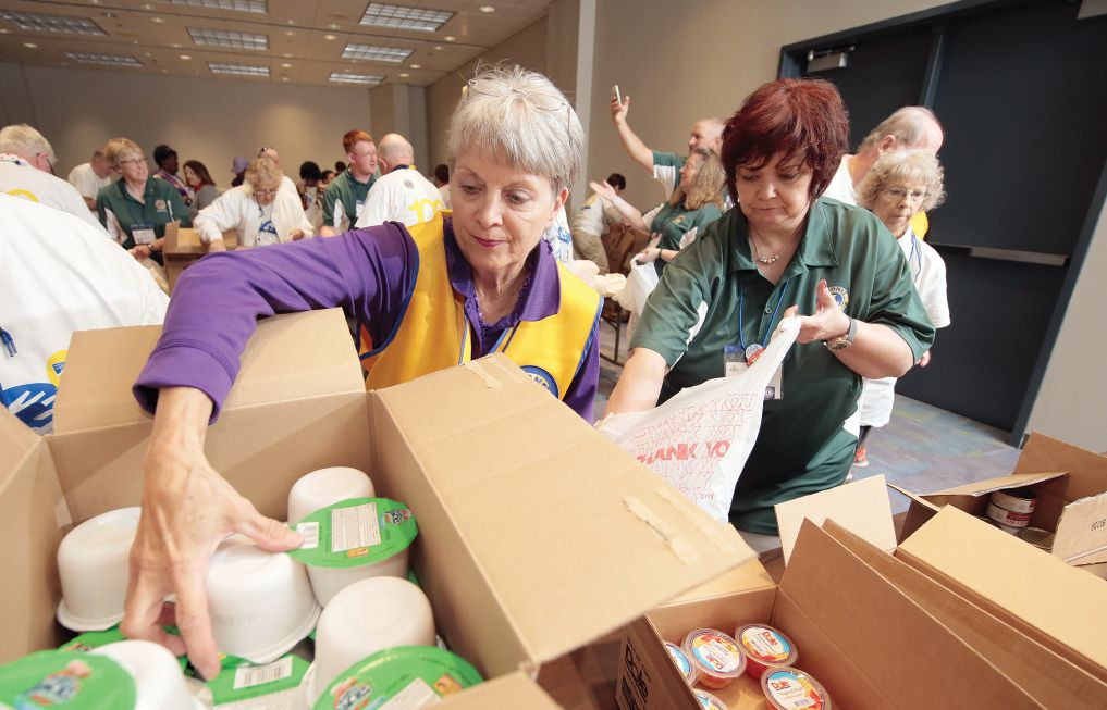 Lions at the recent 100th International Convention in Chicago pack bags of nutritious weekend meals for elementary school students.