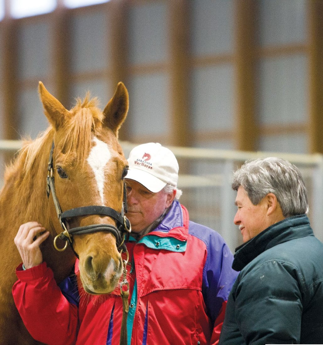 Vietnam veteran Russ Terpening, a Lion, bonds with Kit, a retired thoroughbred at Saratoga WarHorse.