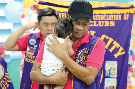 The Legazpi City Host Lions Club in the Philippines provides food and clothing to abandoned children.