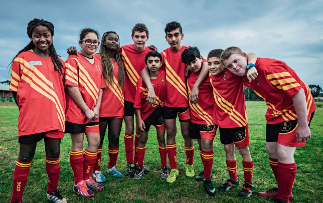 The Jesmond Rams under-14 team includes four children from refugee families including Afghanistan-born Hakmat Fatah (fifth from right). Photo by Michael Wee