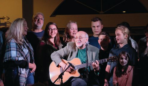 Folk singer Peter Yarrow performs with some of his fans at the Bolton Lions' Legends of Music Concert Series.