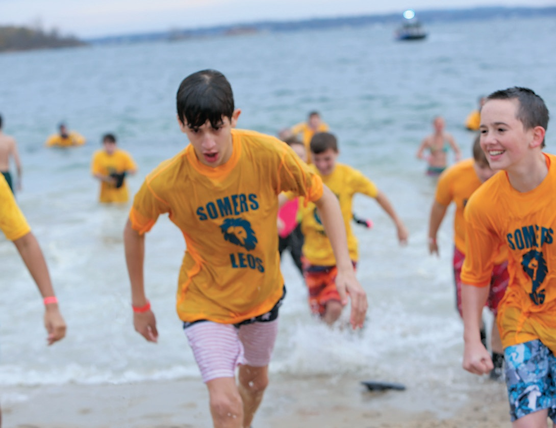 Somers Leos emerge from a frigid plunge, raising more than US$27,000 to benefit Special Olympics. Photo by Deborah Karson