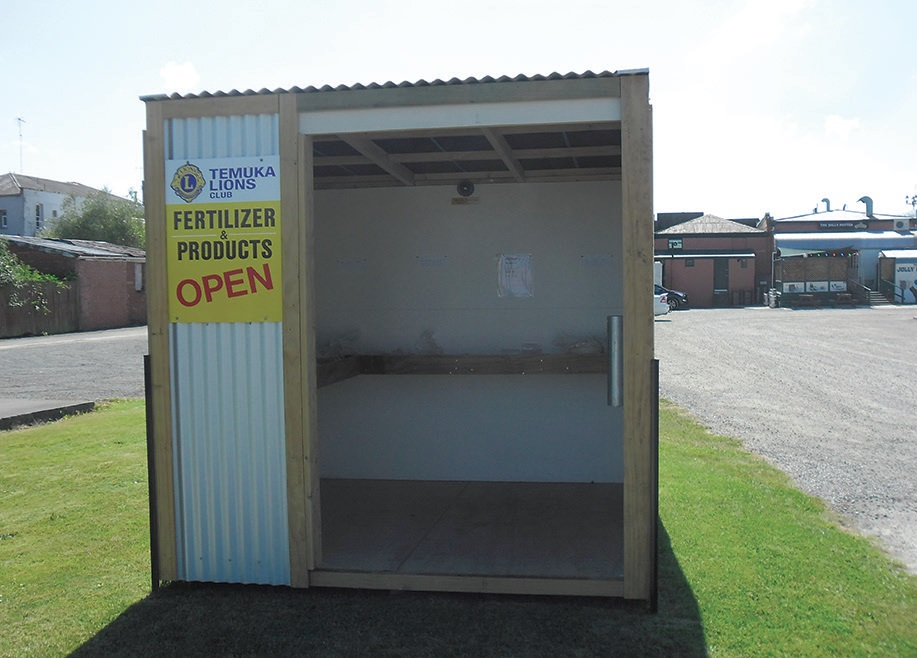 The Temuka Lions in New Zealand sell several different types of fertilizer at their roadside stand, relying on an honesty box to collect payment.