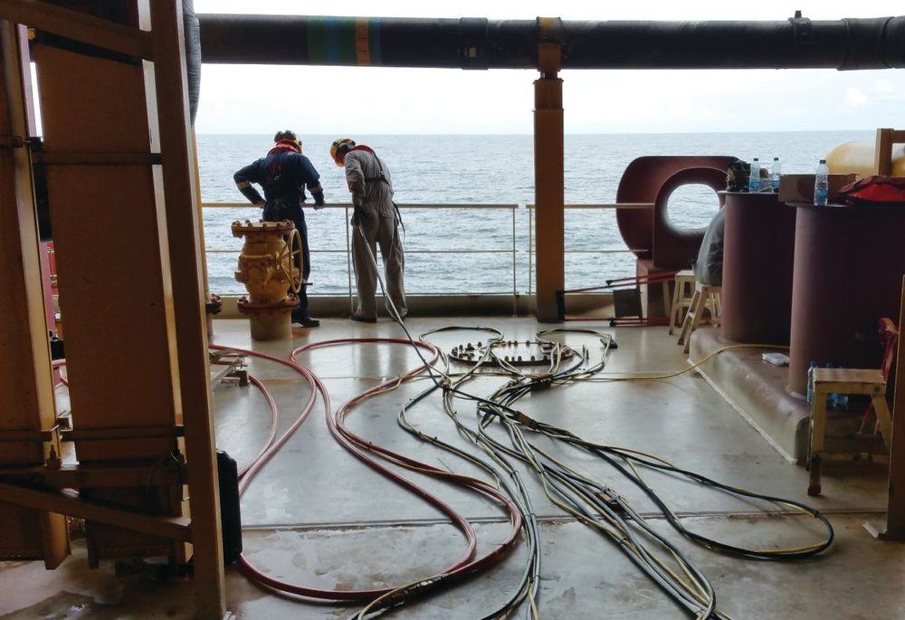 Mission Specialist is over the side, on deck is tether married to stiff high pressure hose for cavitation cleaning.