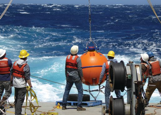 Members of the Tasman Tidal Dissipation Experiment Team recover a DeepWater Buoyancy ADCP buoy aboard the R/V Revelle on an exceptionally windy day in the East Tasman Sea. Photo credit: Sonya Legg, Princeton University.