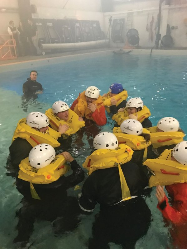 Students preparing for group formation and group movement as part of surface water survival. Photo credit: Survival Systems USA, Inc.