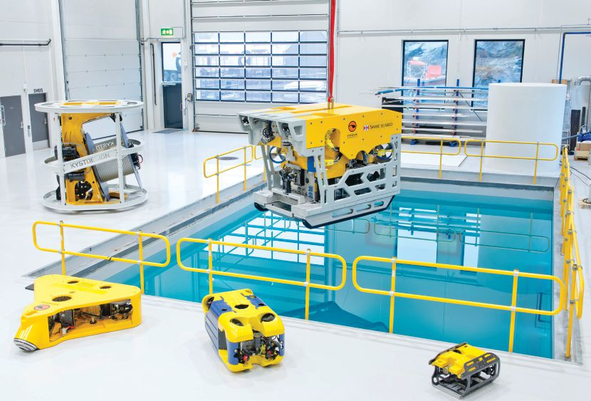 Kystdesign's new workshop facility with various ROVs by the new test pool.