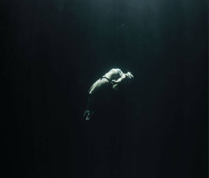 Maca Benitez deep inside a cenote in Playa del Carmen, Mexico. Photo credit: Amanda Cotton.